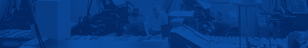 blue hued banner image of factory worker at machine conveyor
