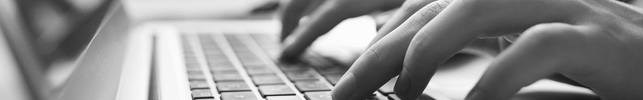yearbooks header image - hands typing at a keyboard